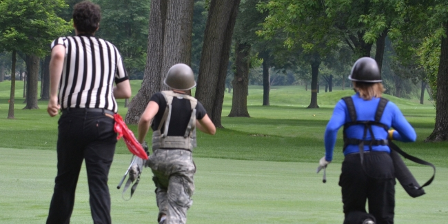 Referee Joe Hamid (left), Nick Caramagno and Paul Lubanski sprint to the next Wilderness Golf shot on Dearborn Country Clubs 16th hole.